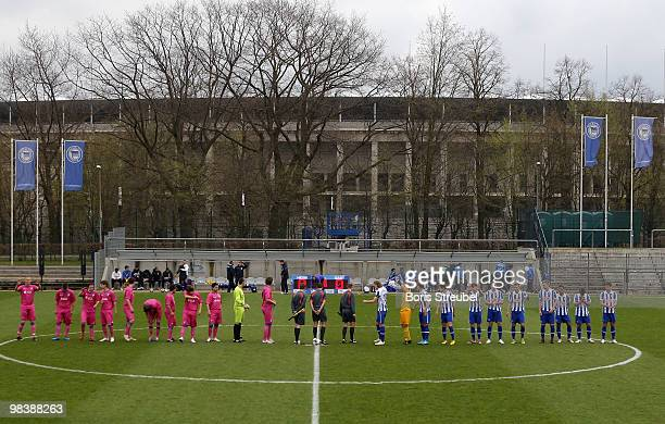 The teams of Berlin and Bochum line up in front of the Olympiastadion Berlin prior to the DFB Juniors Cup half final between Hertha BSC Berlin and...