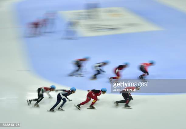 The teams of Canada China South Korea and Hungary compete during the men's 5000m relay final at the ISU World Short Track Speed Skating Championships...