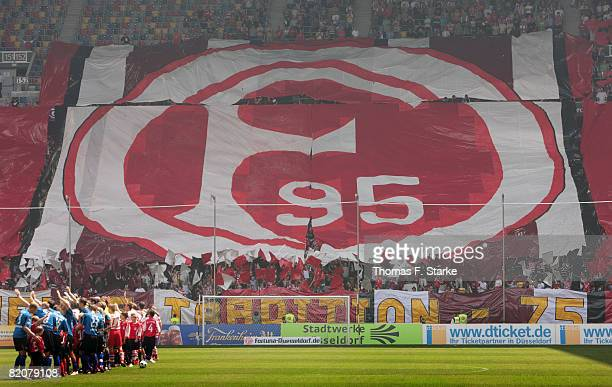 The teams of Duesseldorf and Paderborn are seen with a banner of the Fortuna Duesseldorf logo in background ahead of the 3 Bundesliga match between...