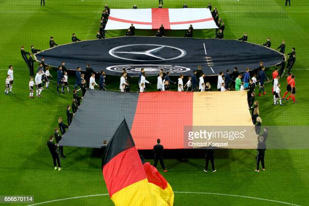 The teams of England and Germany enter the pitch prior to the international friendly match between Germany and England at Signal Iduna Park on March...