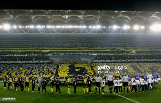 The teams of Fenerbahce and Schalke march into the stadium before the Champions League Group E match between Fenerbahce and Schalke 04 at the Sukru...