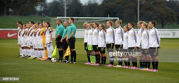 The teams of Germany and England line up for the National Anthems during the International Friendly match between U16 Girl's England v U16 Girl's...