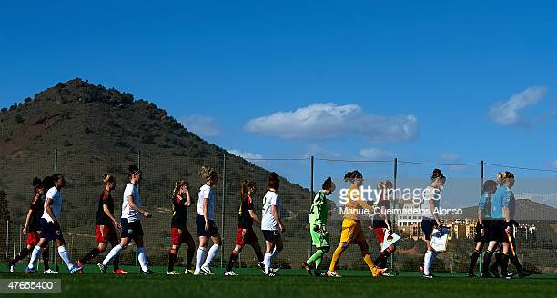 The teams of Germany and England walk onto the pitch prior to the U23 friendly match between England and Germany at la Manga Club on March 3 2014 in...