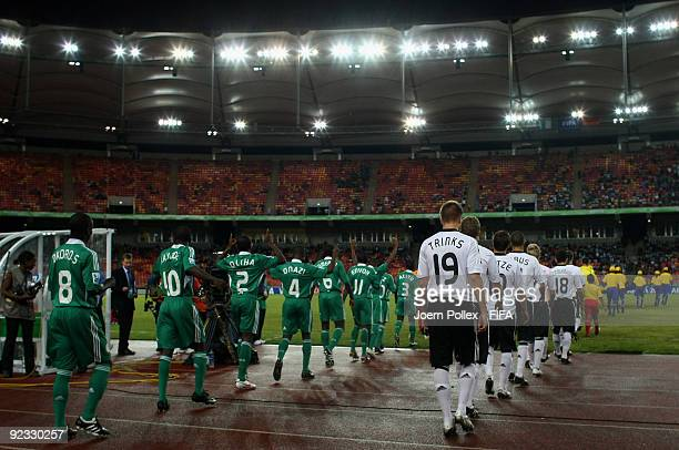 The teams of Germany and Nigeria are seen on their way to the pitch of the FIFA U17 World Cup Group A match between Nigeria and Germany at the Abuja...