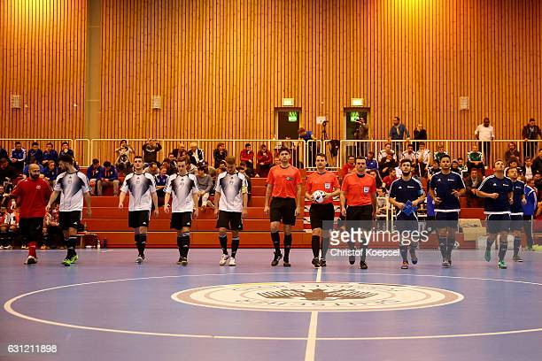 The teams of Hamburg and Bavaria enter the pitch prior to the final match of the DFB Futsal Federal Cup 2017 at Sport School Wedau on January 8 2017...