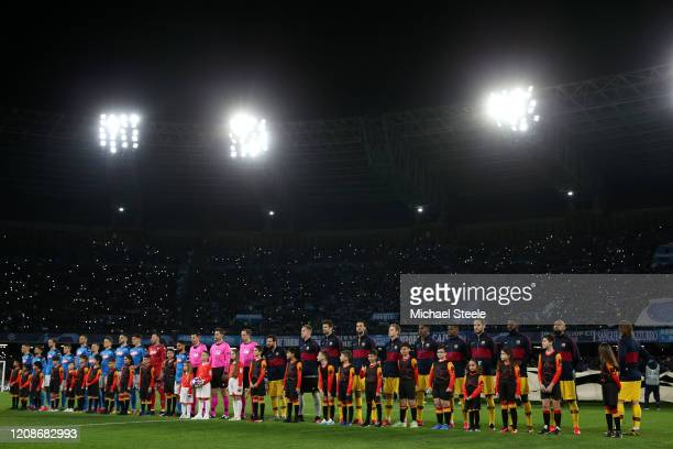 The teams of Napoli and Barcelona line up ahead of the UEFA Champions League round of 16 first leg match between SSC Napoli and FC Barcelona at...