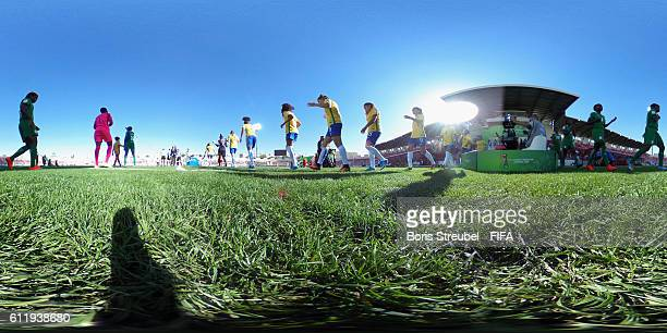 The team's of Nigeria and Brazil enter the pitch during the FIFA U17 Women's World Cup Group C match between Nigeria and Brazil at King Abdullah II...