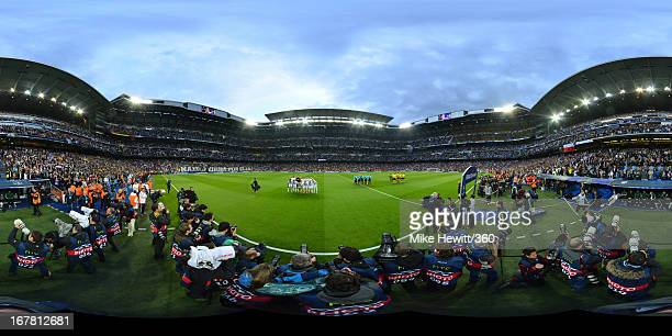 The teams of Real Madrid CF and Borussia Dortmund line up prior to the UEFA Champions League Semi Final Second Leg match between Real Madrid and...