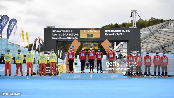 The teams of second placed Ethiopia, first placed Kenya and third placed Uganda stand on the podium after collecting their respective medals for the...
