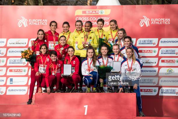 The teams of Spain Germany and Great Britain Northern Ireland celebrate their medals during the U23 Women's award ceremony of the SPAR European Cross...