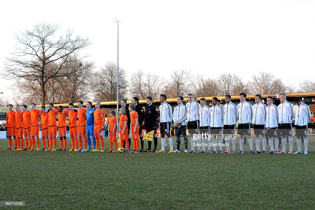 The teams of The Netherlands and Germany line up before the start of the U18 International Friendly match between The Netherlands and Germany on March 26, 2013 in Vriezenveen, Netherlands.