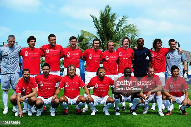 The teams pose before the Laureus Football Challenge presented by IWC Schaffhausen as part of the 2011 Laureus World Sports Awards at the Emirates...