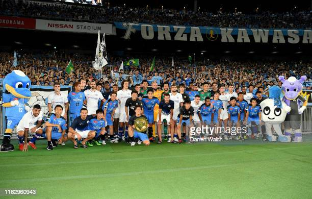 The teams pose for a photo together after the preseason friendly match between Kawasaki Frontale and Chelsea at Nissan Stadium on July 19, 2019 in...