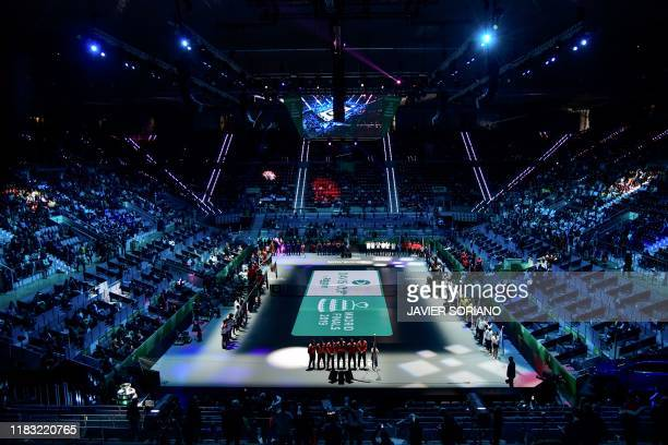 TOPSHOT The teams pose on the court during the opening ceremony of the Davis Cup Madrid Finals 2019 in Madrid on November 18 2019