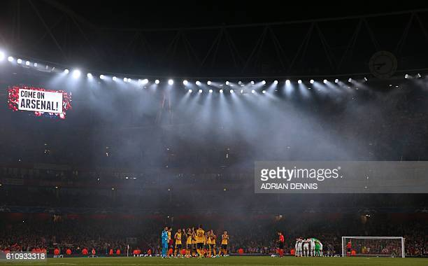 The teams prepare to start the game under the floodlights ahead of the UEFA Champions League Group A football match between Arsenal and FC Basel at...