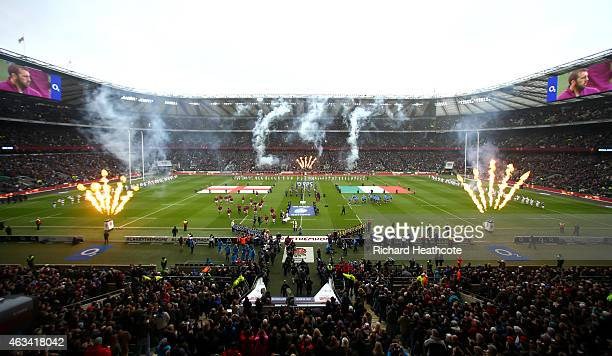 The teams run out for the national anthems during the RBS Six Nations match between England and Italy at Twickenham Stadium on February 14 2015 in...