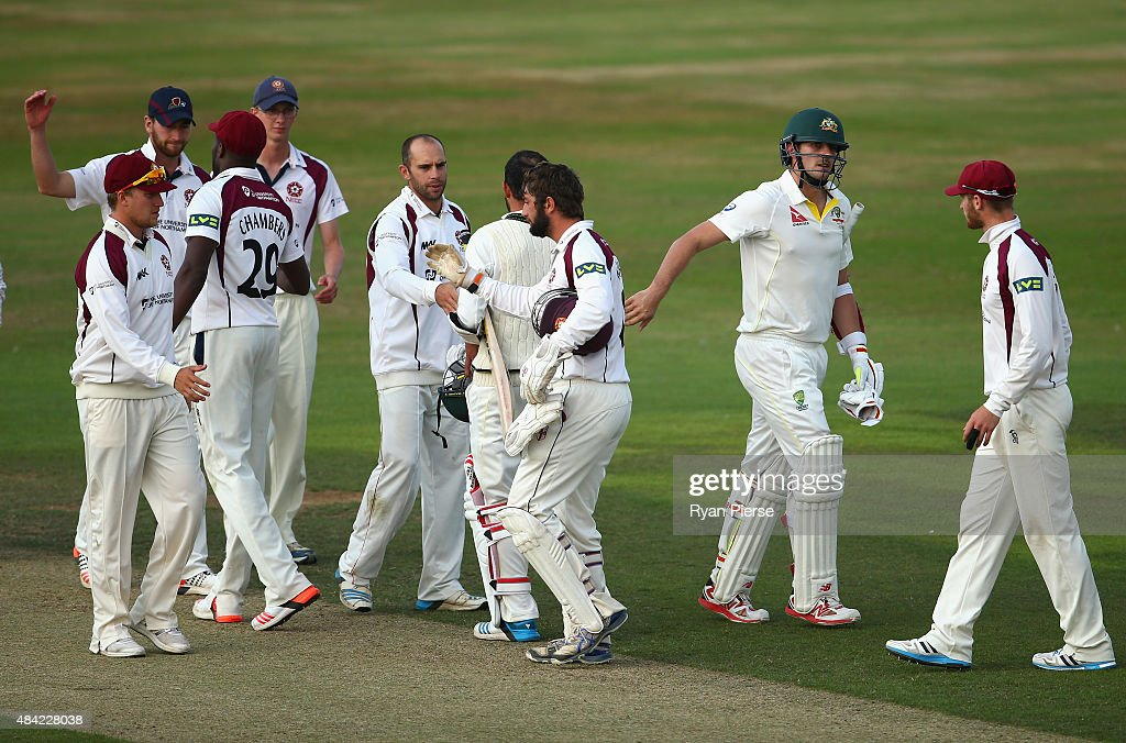 The teams shake hands after the match was drawn during day three of the tour match between Northamptonshire and Australia at The County Ground on August 16, 2015 in Northampton, England.