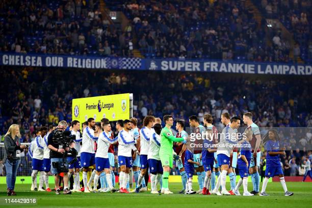 The teams shake hands before the Premier League match between Chelsea FC and Burnley FC at Stamford Bridge on April 22 2019 in London United Kingdom