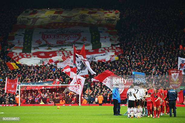 The teams shake hands prior to the Barclays Premier League match between Liverpool and Manchester United at Anfield on January 17 2016 in Liverpool...