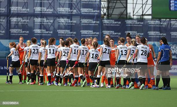 The teams shake hands prior to the Hockey World League Final Pool A match between the Netherlands and Germany at Estadio Mundialista de hockey on...