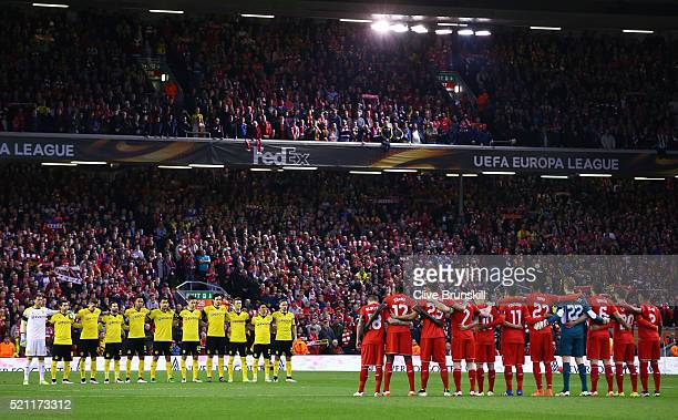 The team's stand for a minute's silence during the UEFA Europa League quarter final second leg match between Liverpool and Borussia Dortmund at...