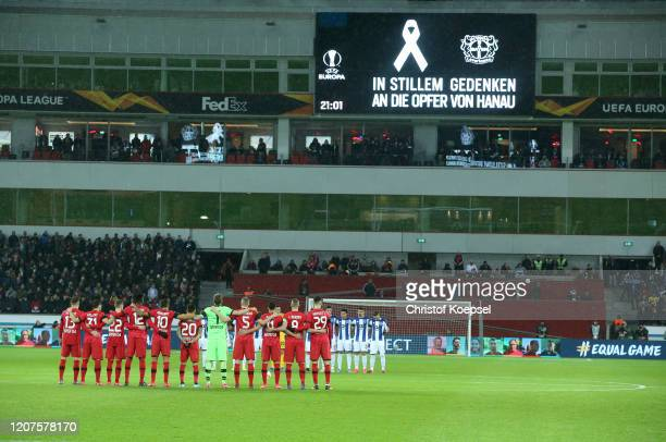The teams stand for a minutes silence for the victims of the Hanau shootings the UEFA Europa League round of 32 first leg match between Bayer 04...