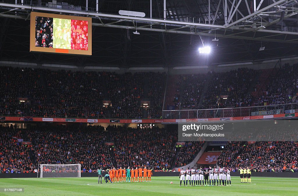The teams stand for a minute's silence to remember those who lost their lives in the Brussels terror attacks during the International Friendly match between Netherlands and France at Amsterdam Arena on March 25, 2016 in Amsterdam, Netherlands.