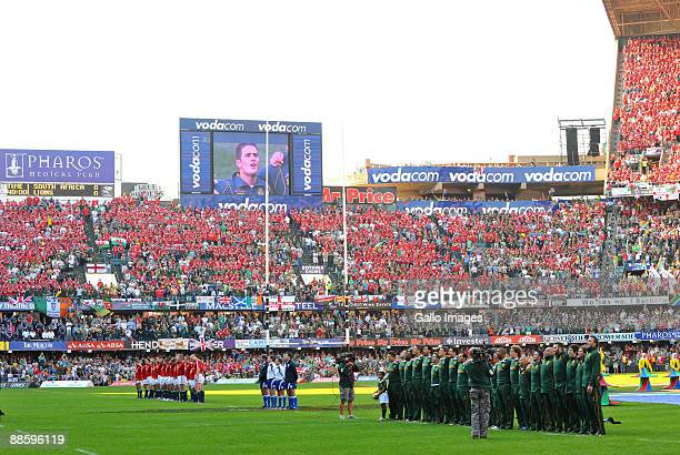 The teams stand for anthems during the First Test match between the South African Springboks and the British and Irish Lions at the Kings Park...