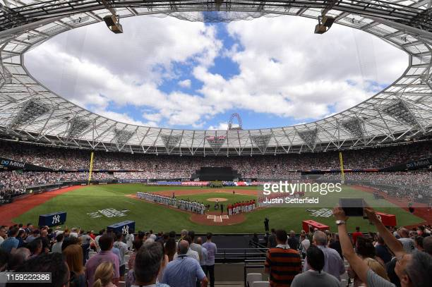 The teams stand for the national anthem during the MLB London Series game between the New York Yankees and the Boston Red Sox at London Stadium on...