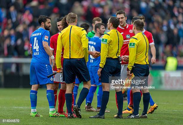 The teams SV Darmstadt 98 FSV Mainz 05 and the referees shaking hands after the game at Coface Arena on March 06 2016 in Mainz Germany