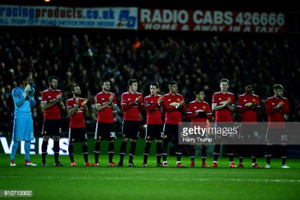 The teams take part in a minutes applause for Jimmy Armfield during The Emirates FA Cup Fourth Round match between Yeovil Town and Manchester United...