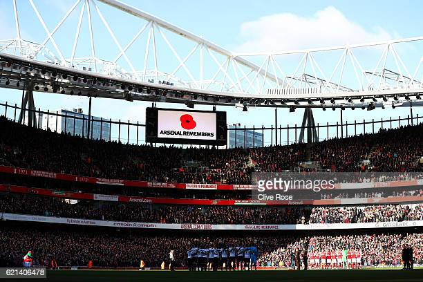 The teams take part in a minutes silence in honour of Remembrance Day prior to the Premier League match between Arsenal and Tottenham Hotspur at...