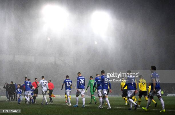 The teams take to field during the Sky Bet Leauge One match between Oxford United and Ipswich Town at Kassam Stadium on January 14 2020 in Oxford...