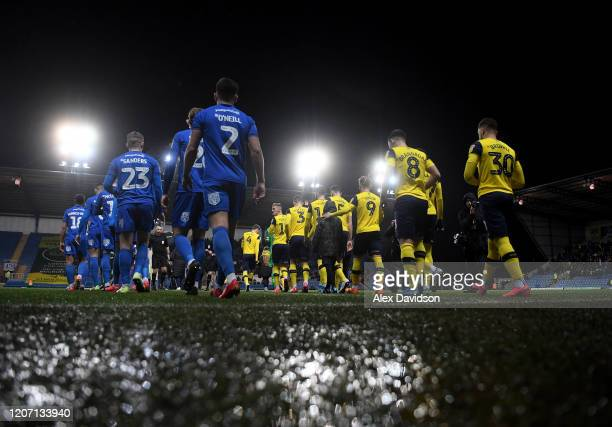 The teams take to the field during the Sky Bet League One match between Oxford United and AFC Wimbledon at the Kassam Stadium on February 18, 2020 in...