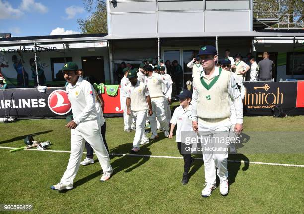 The teams take to the field on the first day of play during the Ireland v Pakistan test cricket match on May 12 2018 in Malahide Ireland