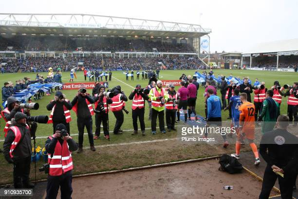 The teams take to the pitch at ABAX Stadium ahead of The Emirates FA Cup Fourth Round tie between Peterborough United and Leicester City at ABAX...