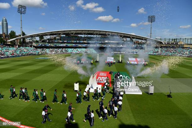 The teams walk on to the field ahead of the ICC Champions Trophy group match between England and Bangladesh at The Kia Oval on June 1 2017 in London...