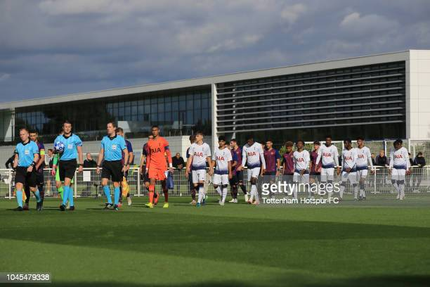 The teams walk out at Hotspur Way during the UEFA Youth League match between Tottenham Hotspur and Barcelona on October 3 2018 in Enfield England