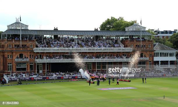 The teams walk out at the start of the NatWest T20 Blast match between Middlesex and Surrey at Lord's Cricket Ground on July 13 2017 in London England