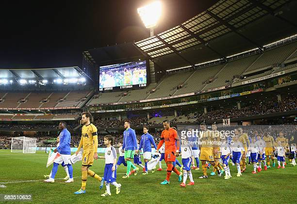 The teams walk out for the 2016 International Champions Cup match between Juventus FC and Tottenham Hotspur at Melbourne Cricket Ground on July 26...