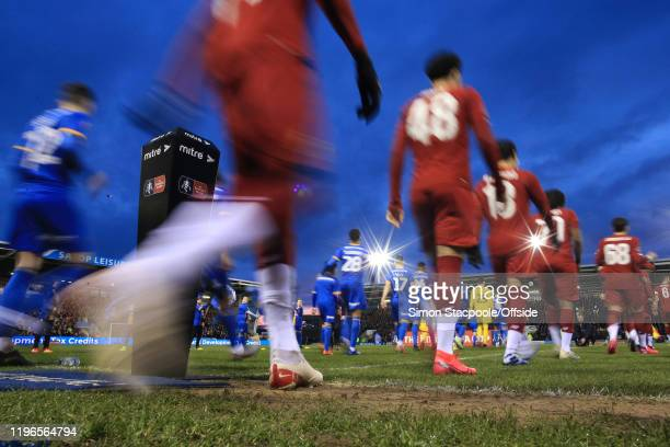 The teams walk out for the FA Cup Fourth Round match between Shrewsbury Town and Liverpool FC at New Meadow on January 26 2020 in Shrewsbury England