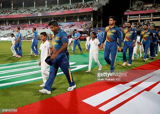 The teams walk out for the national anthem during the ICC World Twenty20 India 2016 match between Sri Lanka and Afghanistan at Eden Gardens on March...