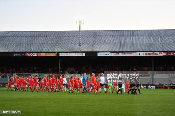 The teams walk out for the national anthems during the Women's World Cup qualifier between Wales Women and England Women at Rodney Parade on August...