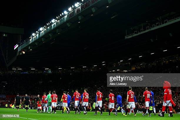 The teams walk out for the start of the Barclays Premier League match between Manchester United and Chelsea at Old Trafford on December 28 2015 in...
