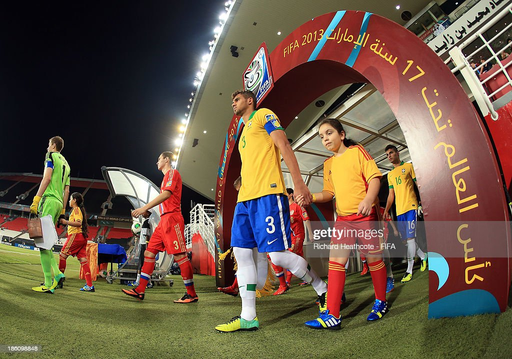 The teams walk out for the start of the FIFA U-17 World Cup UAE 2013 Round of 16 match between Brazil and Russia at the Mohamed Bin Zayed Stadium on October 28, 2013 in Abu Dhabi, United Arab Emirates.