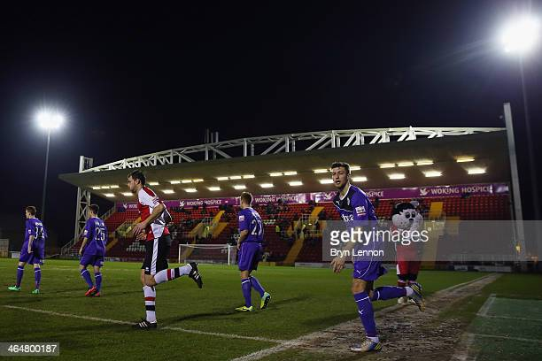 The teams walk out on to the pitch for the Skrill Conference Premier match between Woking and Chester at the Kingfield Stadium on January 21 2014 in...
