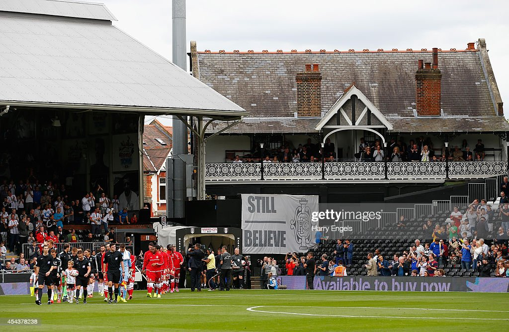 The teams walk out onto the pitch ahead of the Sky Bet Championship match between Fulham and Cardiff City at Craven Cottage on August 30, 2014 in London, England.
