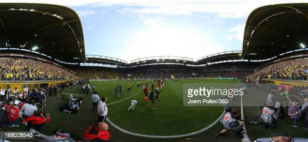 The teams walk out onto the pitch prior to the Bundesliga match between Borussia Dortmund and FC Bayern Muenchen at Signal Iduna Park on May 4 2013...