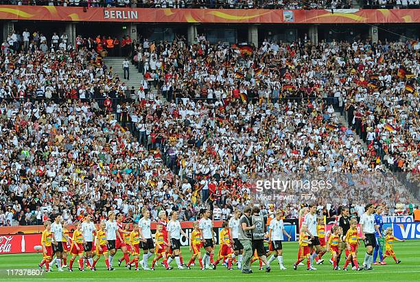 The teams walk out to a full stadium for the FIFA Women's World Cup 2011 Group A match between Germany and Canada at Olympic Stadium on June 26 2011...
