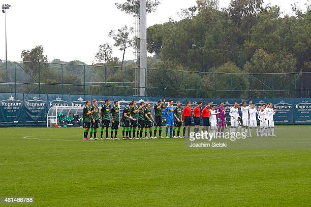 The Teams with the Referees Tobias Reichel Matthias Joellenbeck and Daniel Schlager during the friendly match between Borussia Moenchengladbach and...